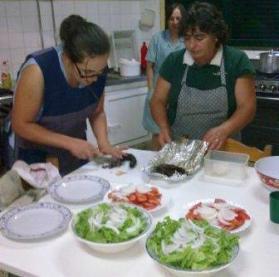 Girls in the Kitchen preparing Chouriço