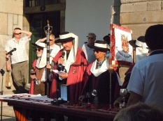 George Sandeman, centre with microphone, and colleagues from the Confraria do Vinho do Porto (The Brotherhood of Port Wine) announce the winners of the race.