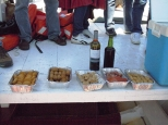 No Portuguese festivity is complete without food: we got to our starting position, dropped anchor, and enjoyed a variety of meat and fish croquettes, broa (cornmeal bread) and sliced choriço. We passed a plateful over the side to our boatmen, along with the bottle of wine and some beer.