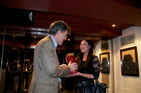 Euan Mackay presents a bottle of Graham's 1969 Single Harvest Port to the satisfied winner of the prize draw.