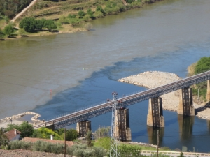 The confluence of the Tua and Douro rivers shows clearly the silt-laden golden water of the Douro