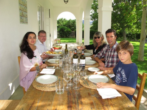 Sancha (left) with Henry to her left, enjoys a well earned lunch after a busy morning, picking grapes. On the right is Joe Álvares Ribeiro (one of Graham's directors, with other guests.