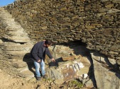 """Arlindo points to a slab of schist (which subsided from the terrace wall) with a flood mark: """"Cheia 1909"""" ('cheia': flood). This will be placed in its original position."""