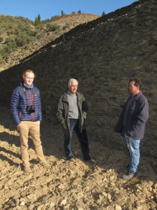 Alexandre (centre) and Arlindo (right) lend scale to the rampart-like dry stone walls supporting the terraces.