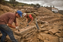 Skilled Douro Stonemasons individually shape each stone to build the dry-stone terrace walls.