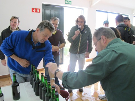 Rupert and Henry guide the visitors from the US through a tasting of recently made Ports in the Malvedos winery.
